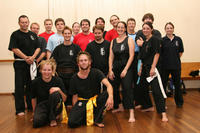 Tara and Calvin - front - are joined by the Seniors after their grading