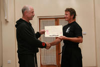 Master Hardy presenting Sifu Hardy with her Black Belt Certificate
