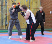 Sensei Carter lands a hand strike with Master Hardy refereeing