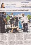 The Canberra Times article with Minister Joy Burch on Grandmaster Hardy's chest