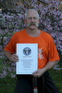 Grandmaster Hardy with the Guinness World Record certificate