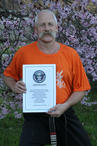 Master Hardy with the 2012 Guinness World Record certificate - greatest weight of concrete broken on his chest while lying on a bed of nails (See Breaking Section)